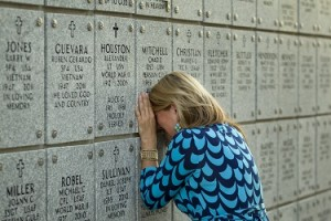 9/11/2012 - Jay Janner/American-Statesman - Kimberly Mitchell weeps at the grave of her husband Chad Mitchell at the Houston National Cemetery in Houston on Tuesday Sept. 11, 2012.   Chad Mitchell, an Iraq War veteran, died of an accidental overdose in 2010.