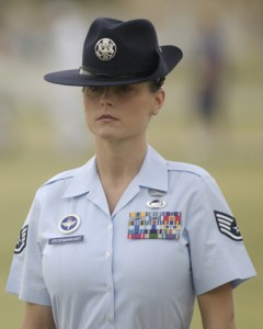 LACKLAND AIR FORCE BASE, Texas -- Staff Sgt. Michelle Crossmanhart stands at attention during a rite of passage shared by all enlisted Airmen -- the Basic Military Training graduation parade.  The parade of 15 squadrons marked the end of the six-week training period for about 750 of the newest Airmen.  Sergeant Crossmanhart is a military training instructor with the 323rd Training Squadron.  (U.S. Air Force photo by Master Sgt. Ken Wright)