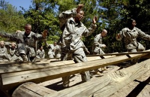 U.S. Army Soldiers make their way through an obstacle during the confidence course portion of basic military training at Fort Jackson, S.C., Sept. 20, 2006. (U.S. Air Force photo by Tech. Sgt. Denise Rayder) (Released)