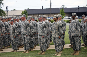 "Soldiers from the Wisconsin and Utah Army National Guard and U.S. Army Reserve sing the Army song after donning the historic ""Old Abe"" patch ceremony at 101st Division Headquarters, at Fort Campbell, Ky., June 16, 2015. The 101st Airborne Division (Air Assault) became the first division headquarters to convert to a multi-component unit division headquarters. The purpose of multi-component unit division headquarters is to fully integrate Reserve and National Guard Soldiers into the modification table of organization and equipment."
