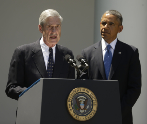 President Barack Obama, right, listens to outgoing FBI Director Robert Mueller, left, during Obama's announcement at he will nominate James Comey, a senior Justice Department official under President George W. Bush, to replace Mueller, as director of the F.B.I., in the Rose Garden of the White House on Friday, June 21, 2013, in Washington. (AP Photo/Pablo Martinez Monsivais)
